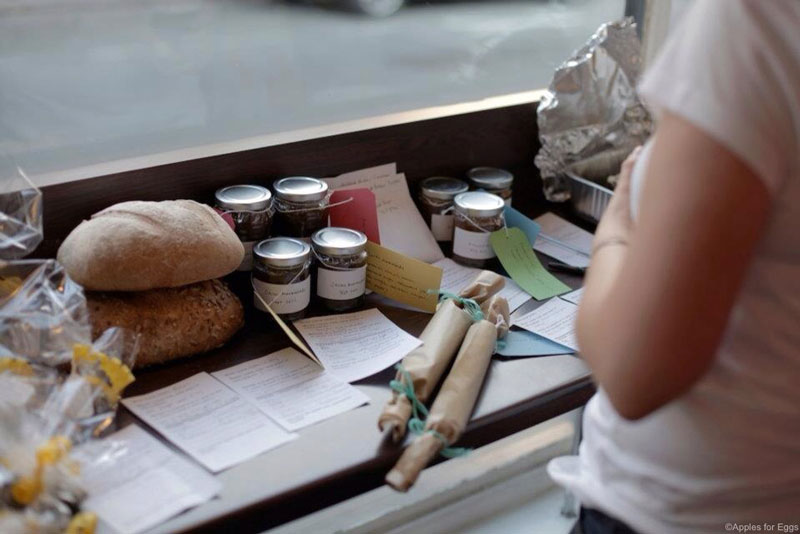 Swappers lay out their produce and what they're willing to swap on cards at a swap in Altrincham. Image © Apples for Eggs